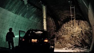 A man stands stranded underground in a collapsed tunnel