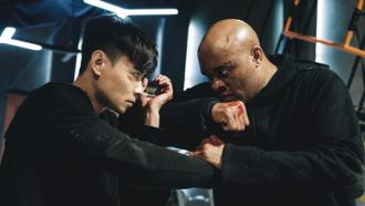 Max Jin Zhang and Anderson Silva in INVINCIBLE DRAGON from Well Go USA