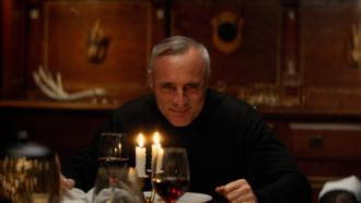 Timothy V. Murphy sits at the table as August Sinclair in BROIL by Well Go USA