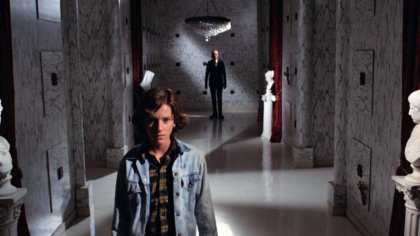 Young boy stands in fear in a cemetery in Phantasm Remastered by Well Go USA