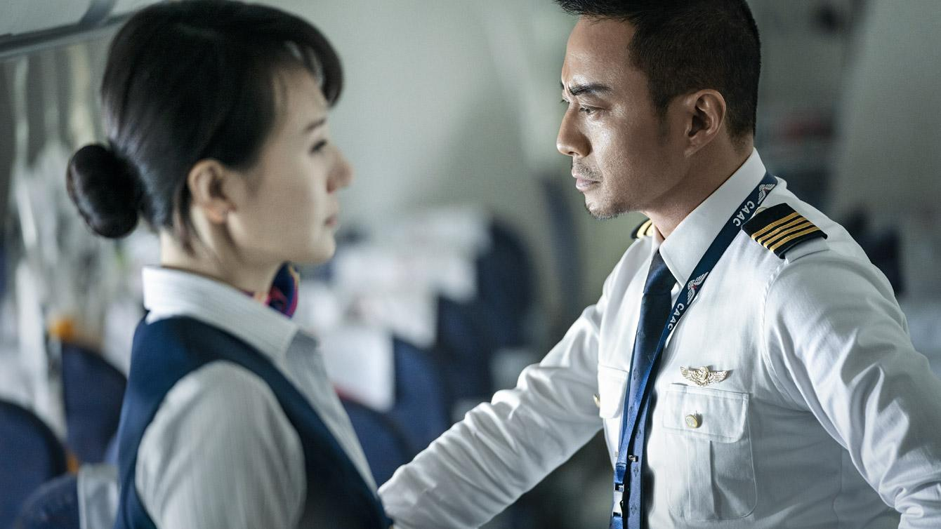 Two flight attendants on Sichuan Airlines flight prepare for emergency landing.