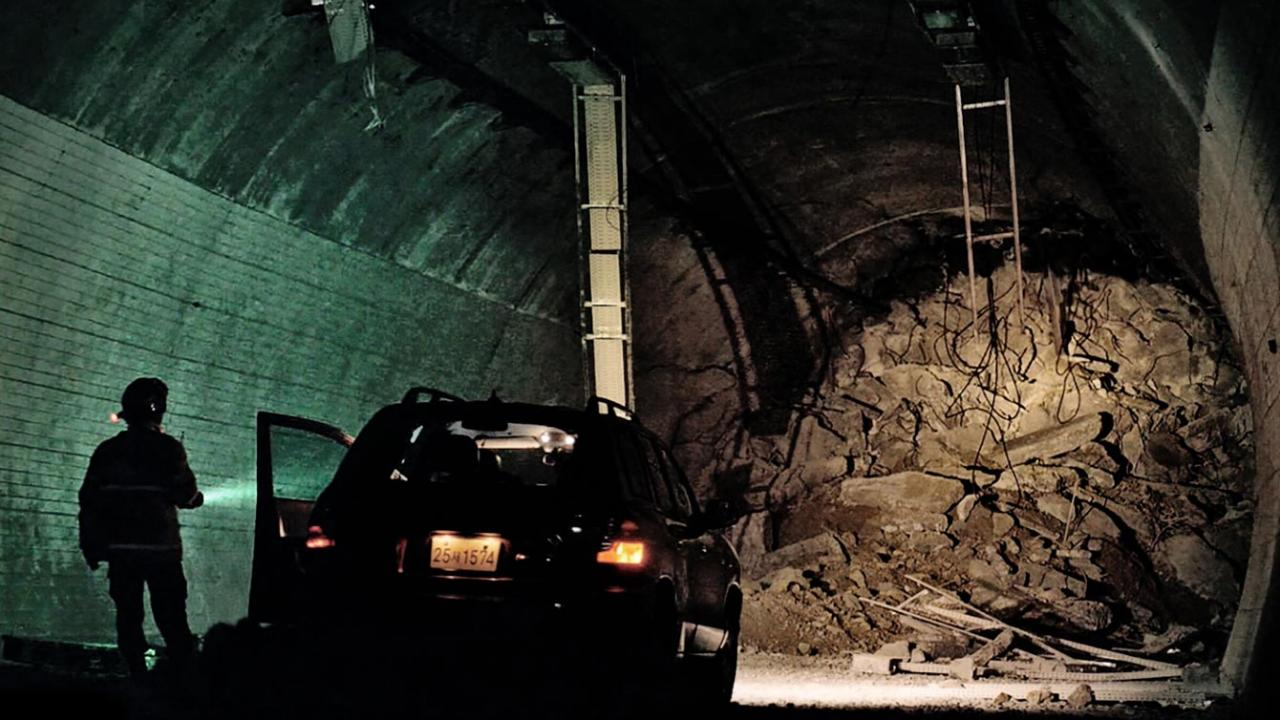 A man is trapped inside a passageway tunnel underground