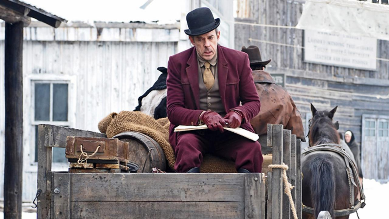A man sits on horse and carriage in the Wild West film The Timber (2015)