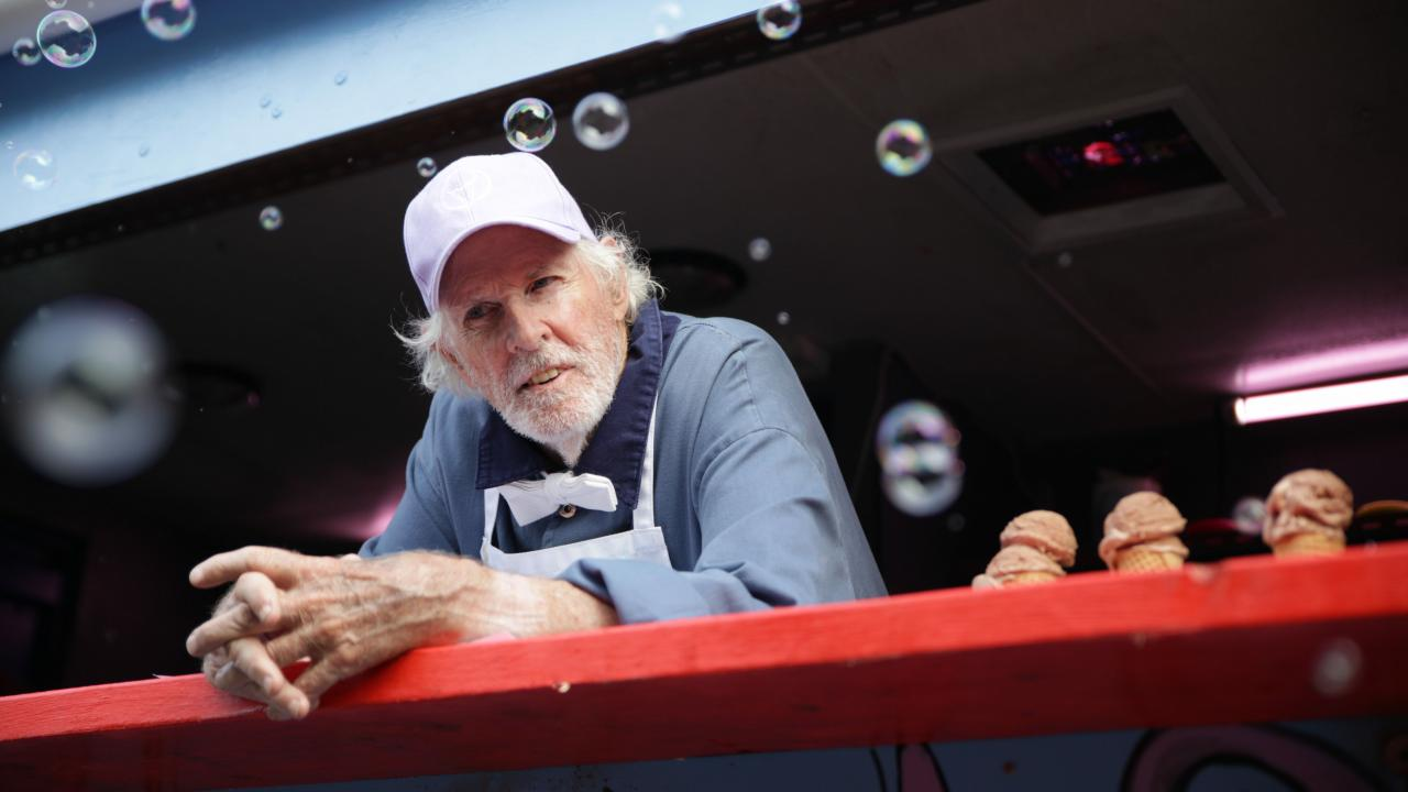 Bruce Dern as Mr. Snowcone, serving scoops of ice cream.