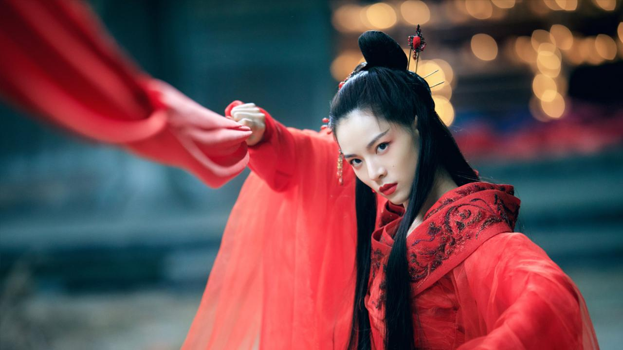 Elane Zhong prepares to fight in striking red cape
