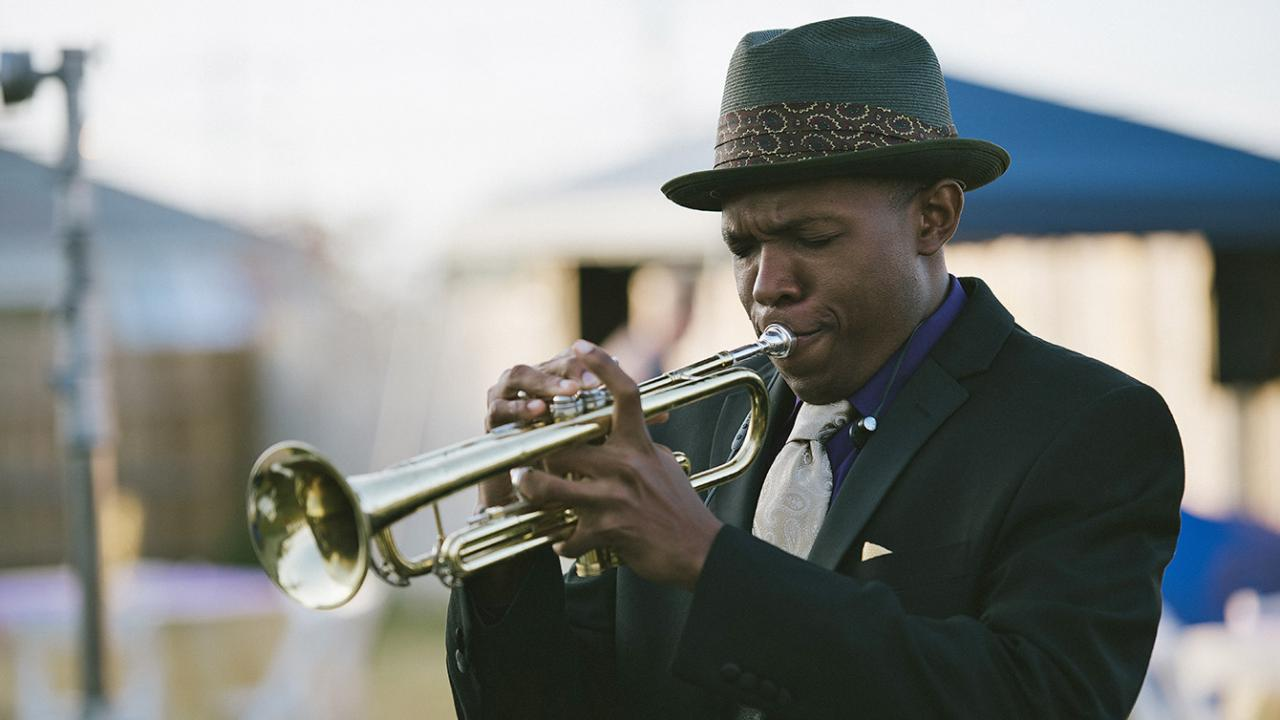 "Denzel Whitacker playing the trumpet as ""Dre"" in Cut Throat City."