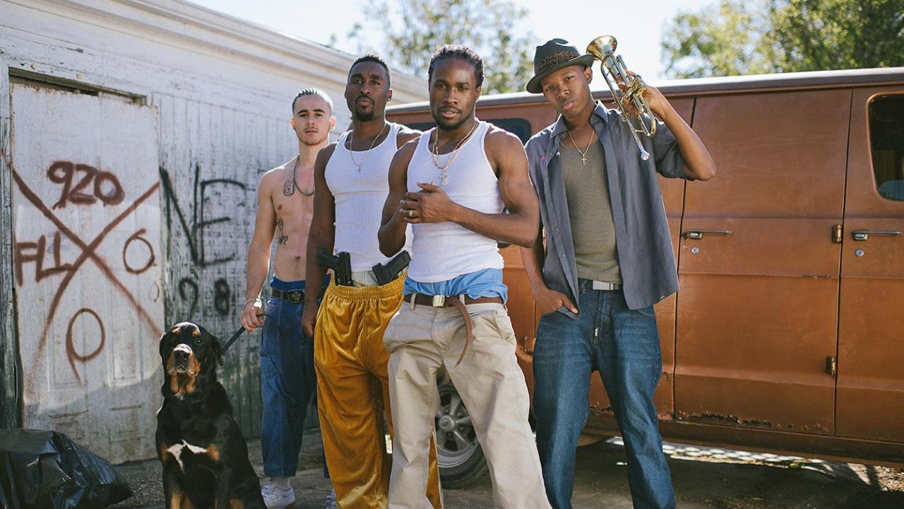Shameik Moore, Demetrius Shipp Jr., Denzel Whitacker, and Keean Johnson pose in front of their van in Cut Throat City.