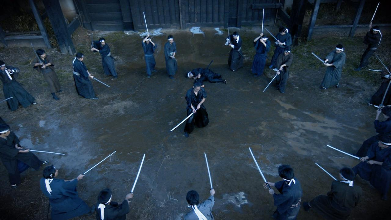 Tak as Miyamoto Musashi facing a ring of swordsmen in CRAZY SAMURAI: 400 vs. 1 by Well Go USA