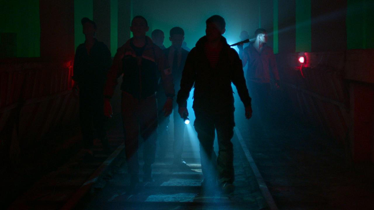 The Russian heist team travels through the factory tunnels in RUSSIAN RAID by Well Go USA Entertainment