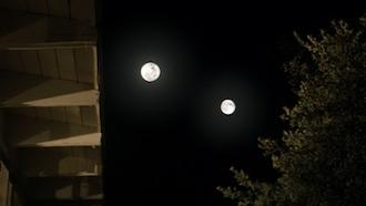 Two moons in the dark sky of film The Endless