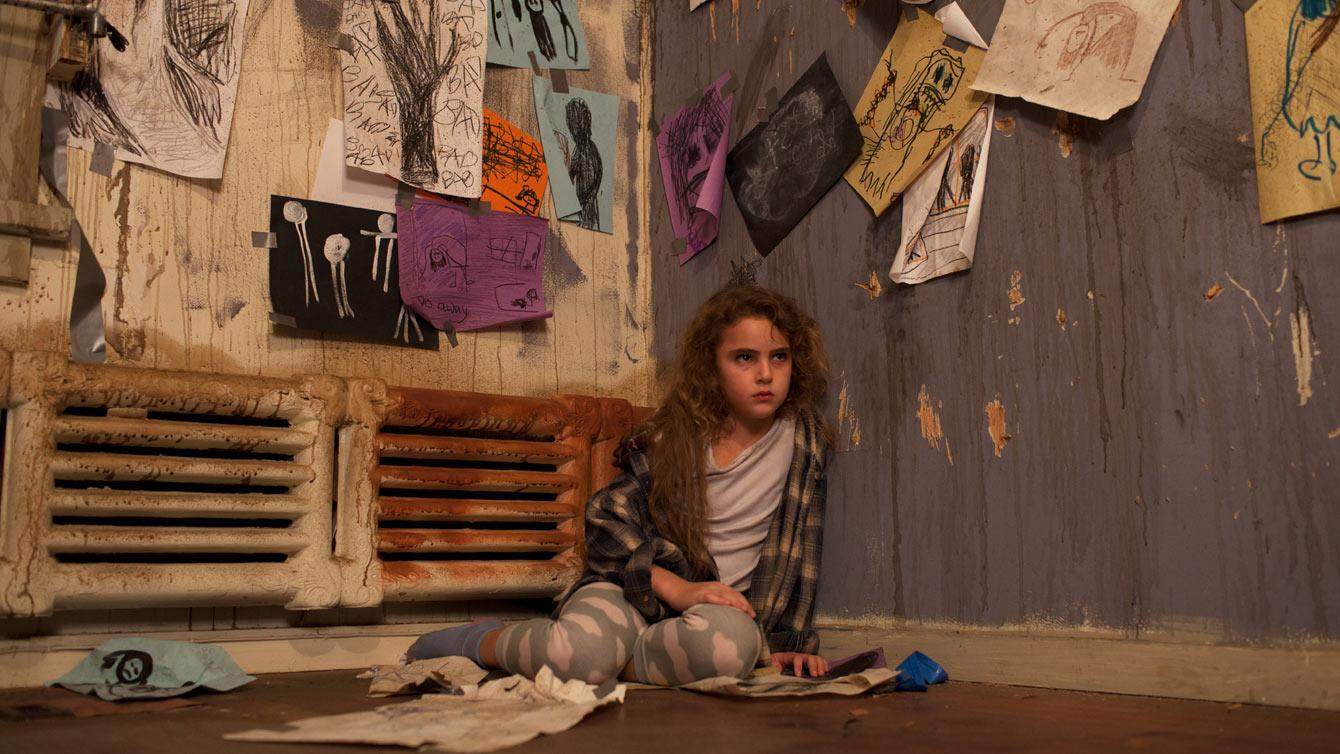 In the sci-fi movie FREAKS, Lexy Kolker is locked inside the house by her paranoid father.