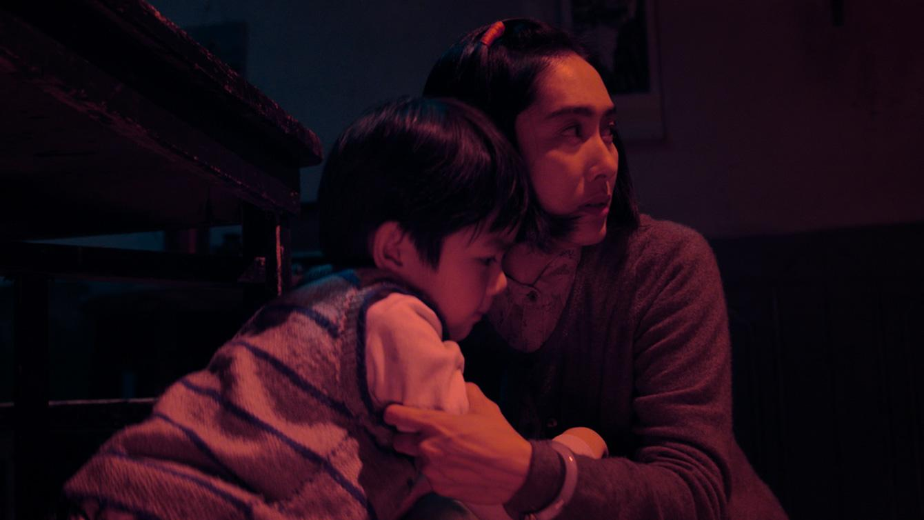 A woman and son face evil spirits in the Korean horror film The Lingering