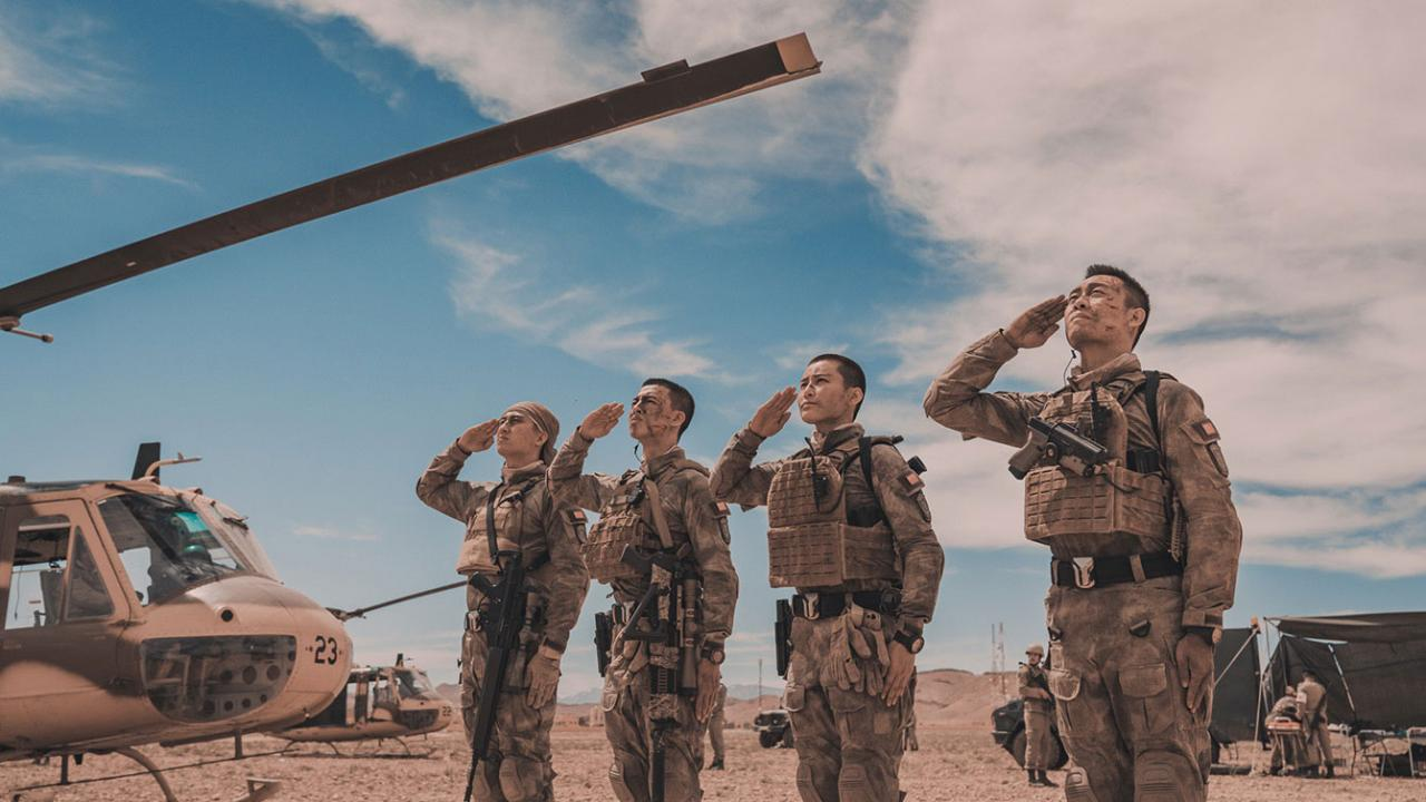 Four soldiers stand and salute in OPERATION RED SEA movie
