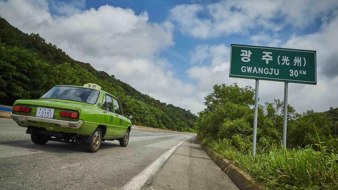 Green taxi drives on Korean highway