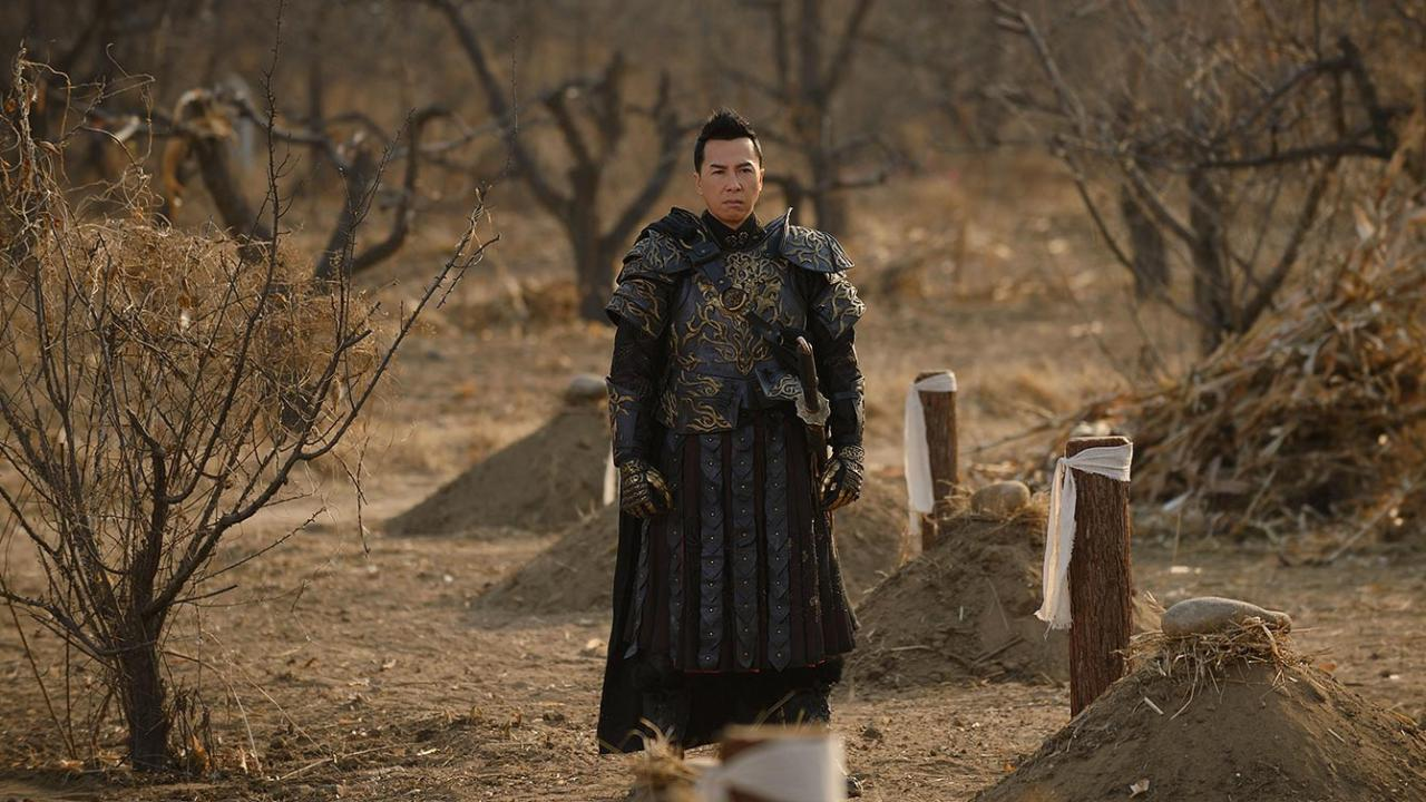 Donnie Yen stands in breastplate in deserted forest on guard in Iceman 2