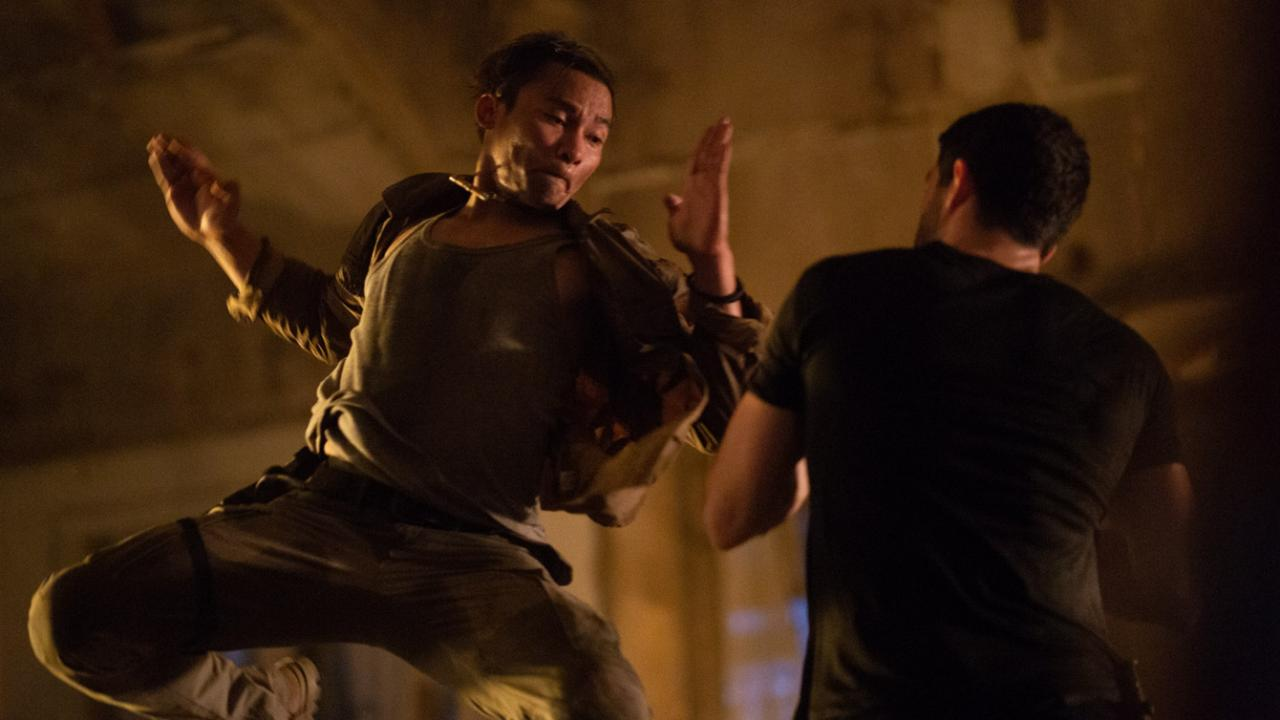 Tony Jaa jumps and strikes opponent