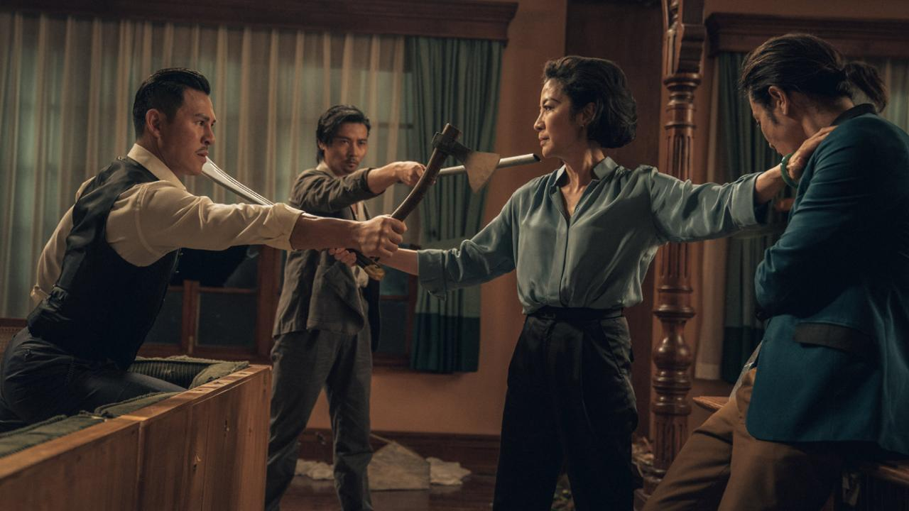 Michelle Yeoh is cornered by three attacks,