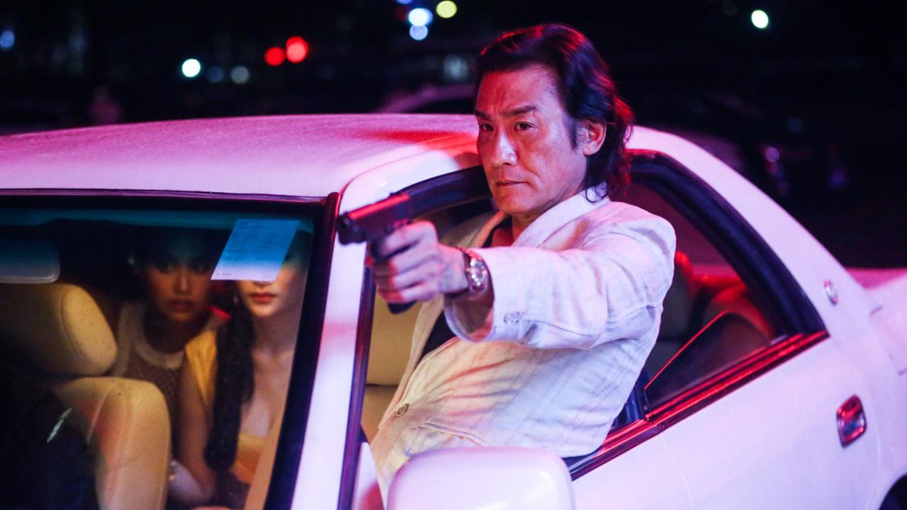 Veteran actor Tony Leung leads gang shoot outs from a car chase scene.