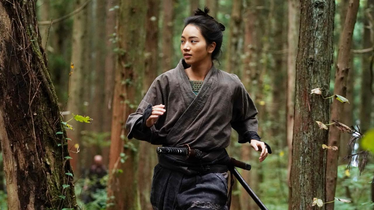 Young samurai princess runs through the forest
