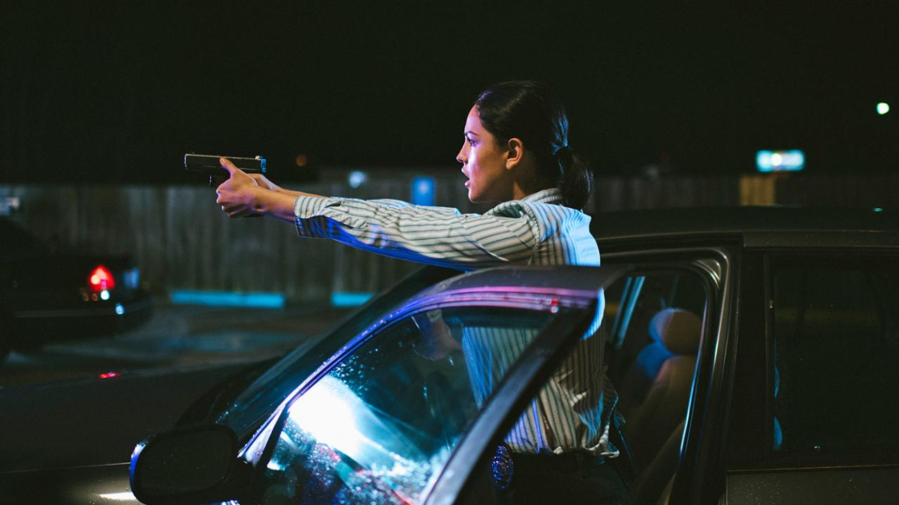 "Eiza Gonzalez shooting her gun as ""Detective Valencia"" in Cut Throat City."