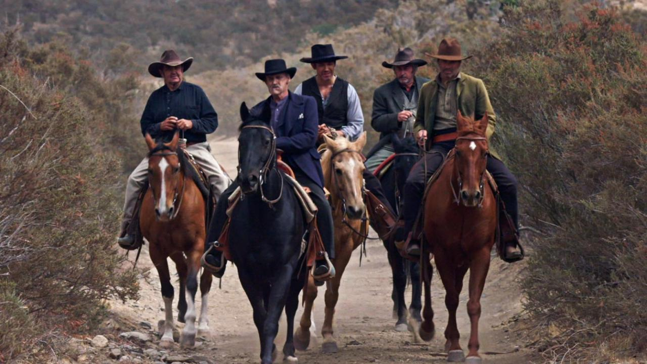 A gang of men gallop across the frontier on horseback in A SOLDIER'S REVENGE.