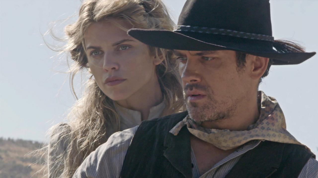 Close-up of Neal Bledsoe and AnnaLynne McCord in A SOLDIER'S REVENGE.