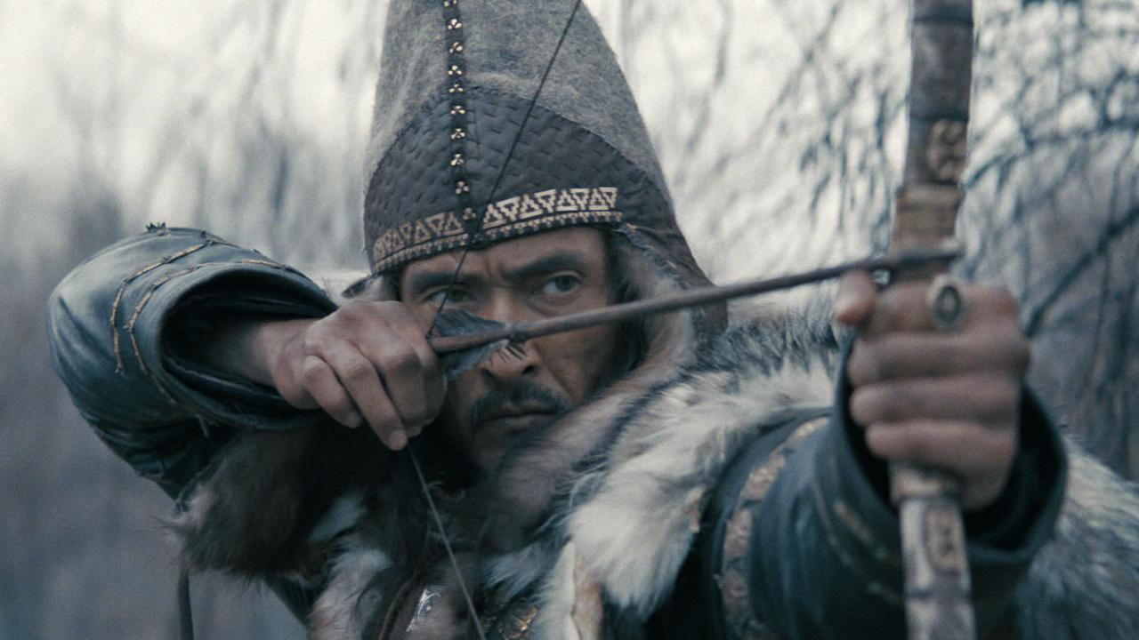 Close-up of male warrior shooting an arrow in THE LEGEND OF TOMIRIS