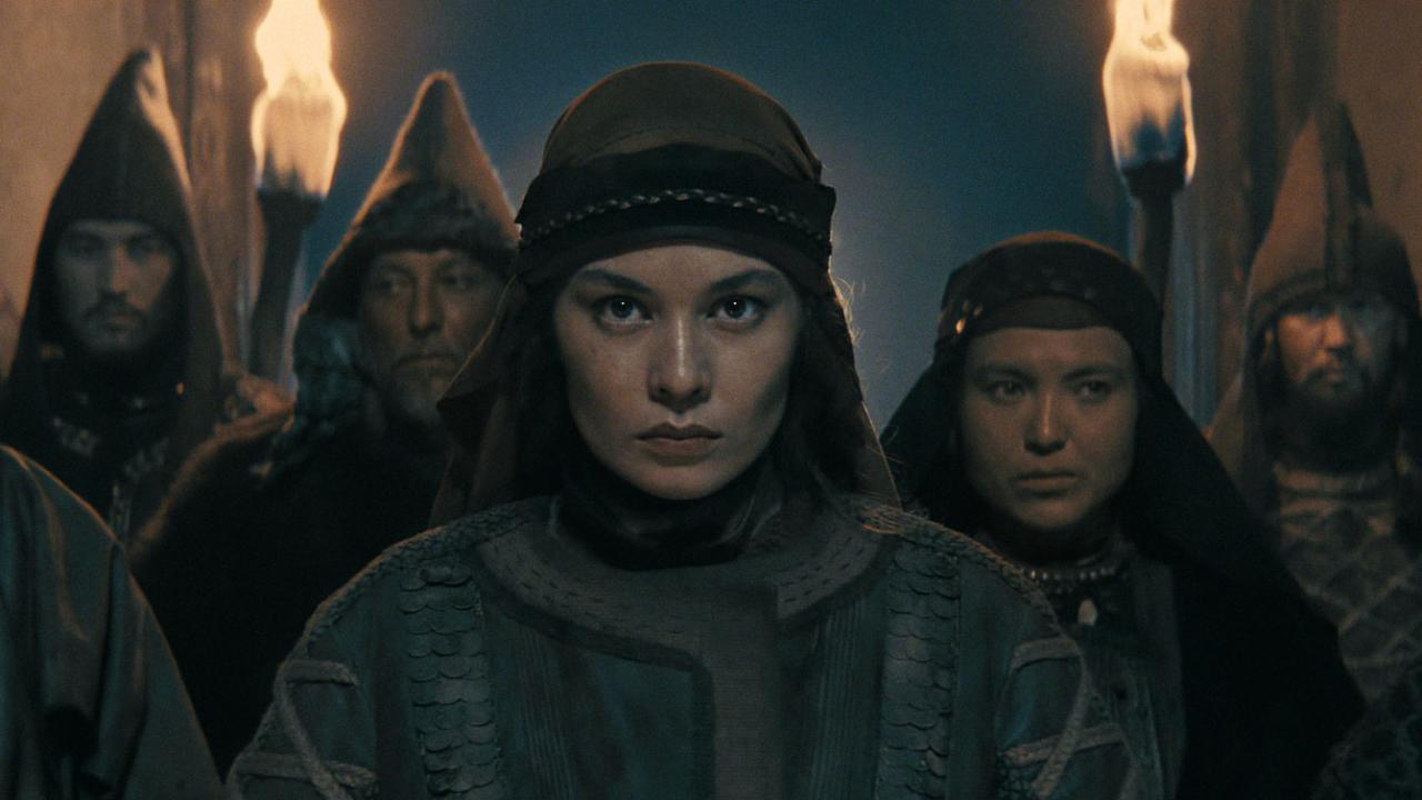 Almira Tursyn pictured at the head of a group in THE LEGEND OF TOMIRIS