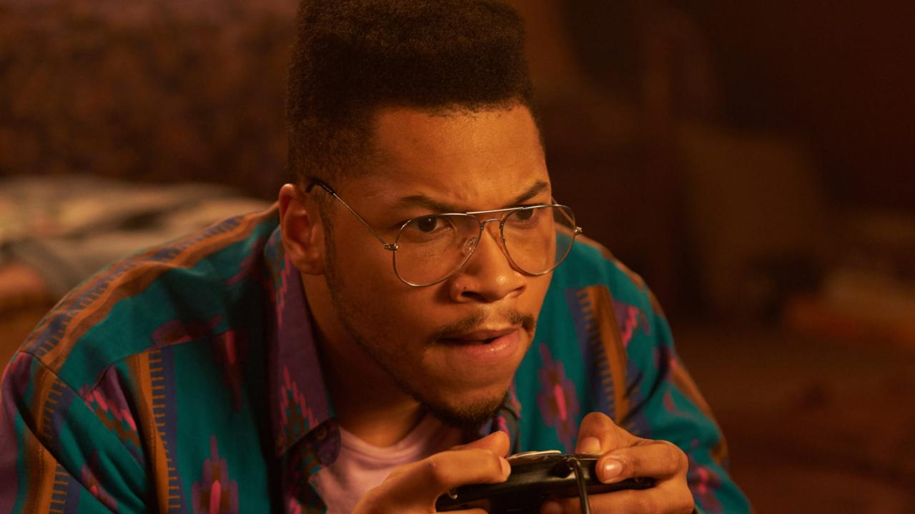 Franz Drameh holding the game controller in MAX CLOUD for Well Go USA