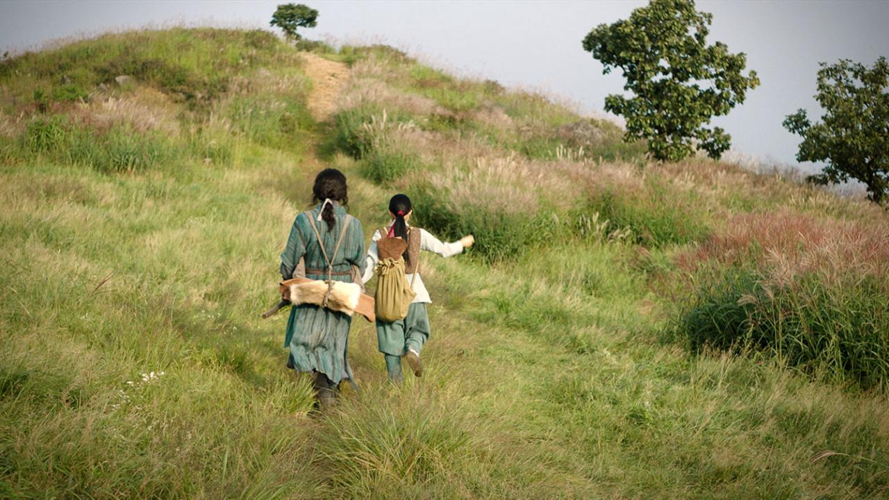 Joseon's greatest swordsman walks a hillside with his daughter in THE SWORDSMAN Korean martial arts film from Well Go USA