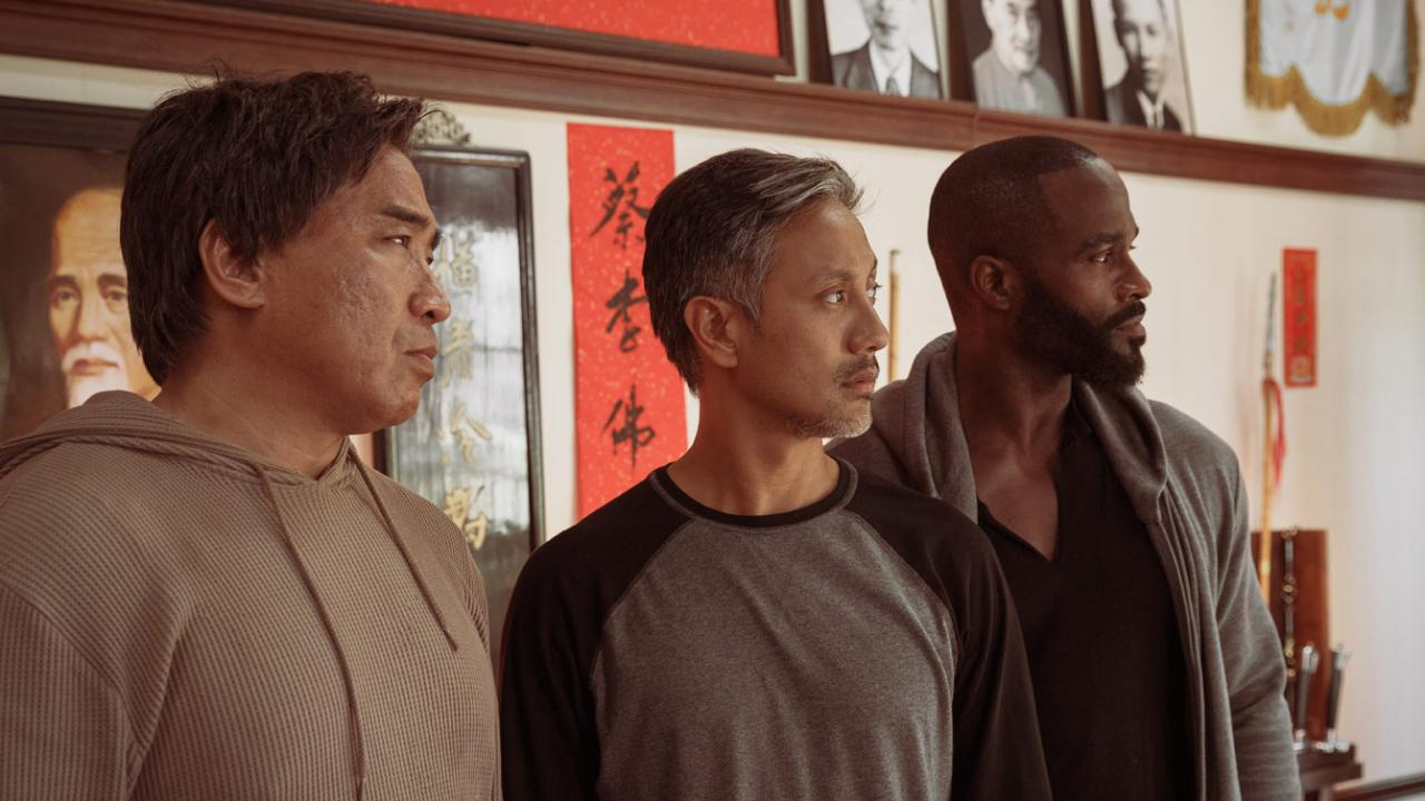 Ron Yuan, Alain Uy, and Mykel Shannon Jenkins stand together in martial arts comedy THE PAPER TIGERS by Well Go USA